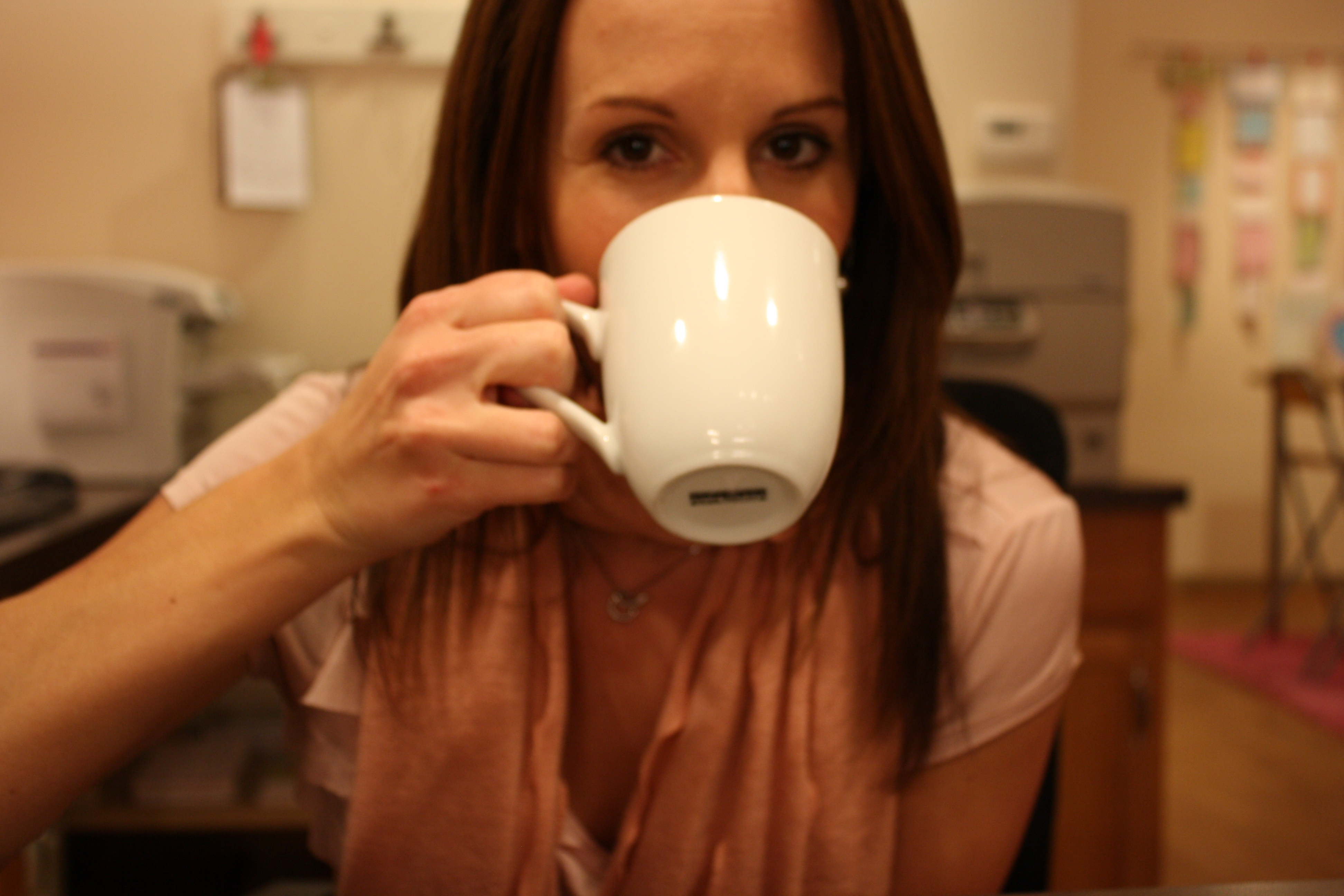 girl drinking coffee at work