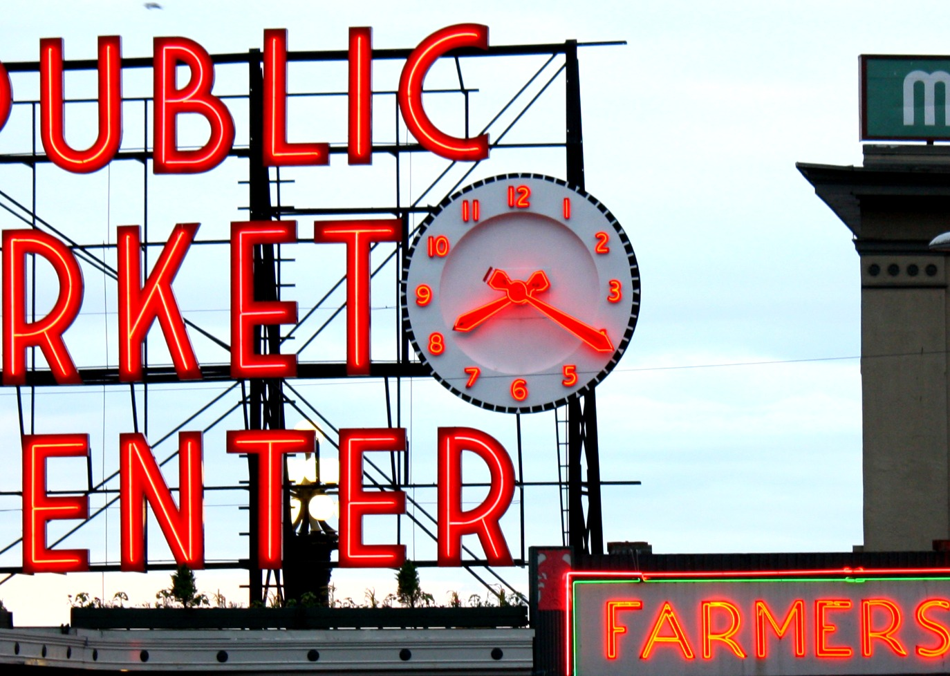 public market center neon sign with clock in seattle washington