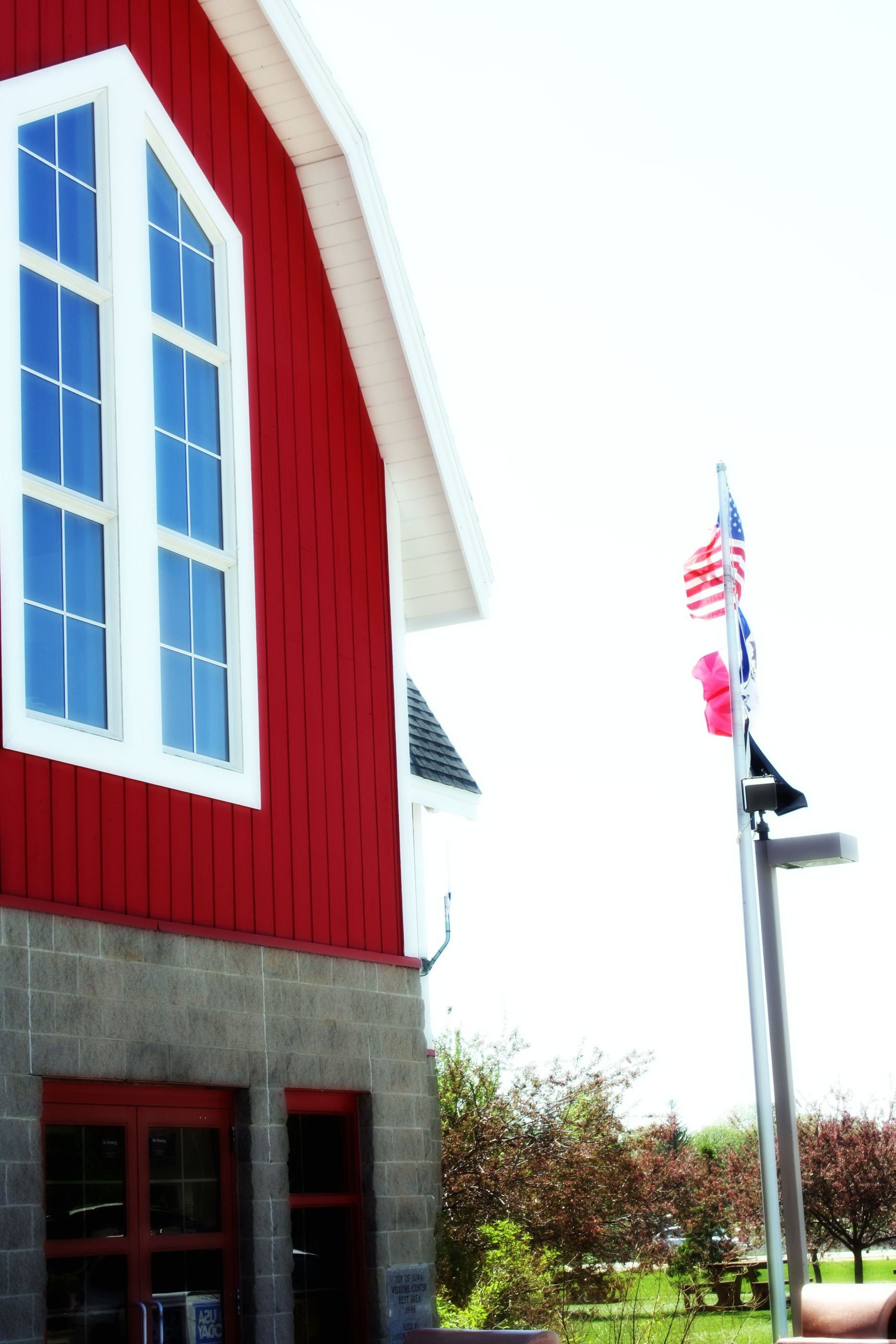 red barn with flagpole in iowa