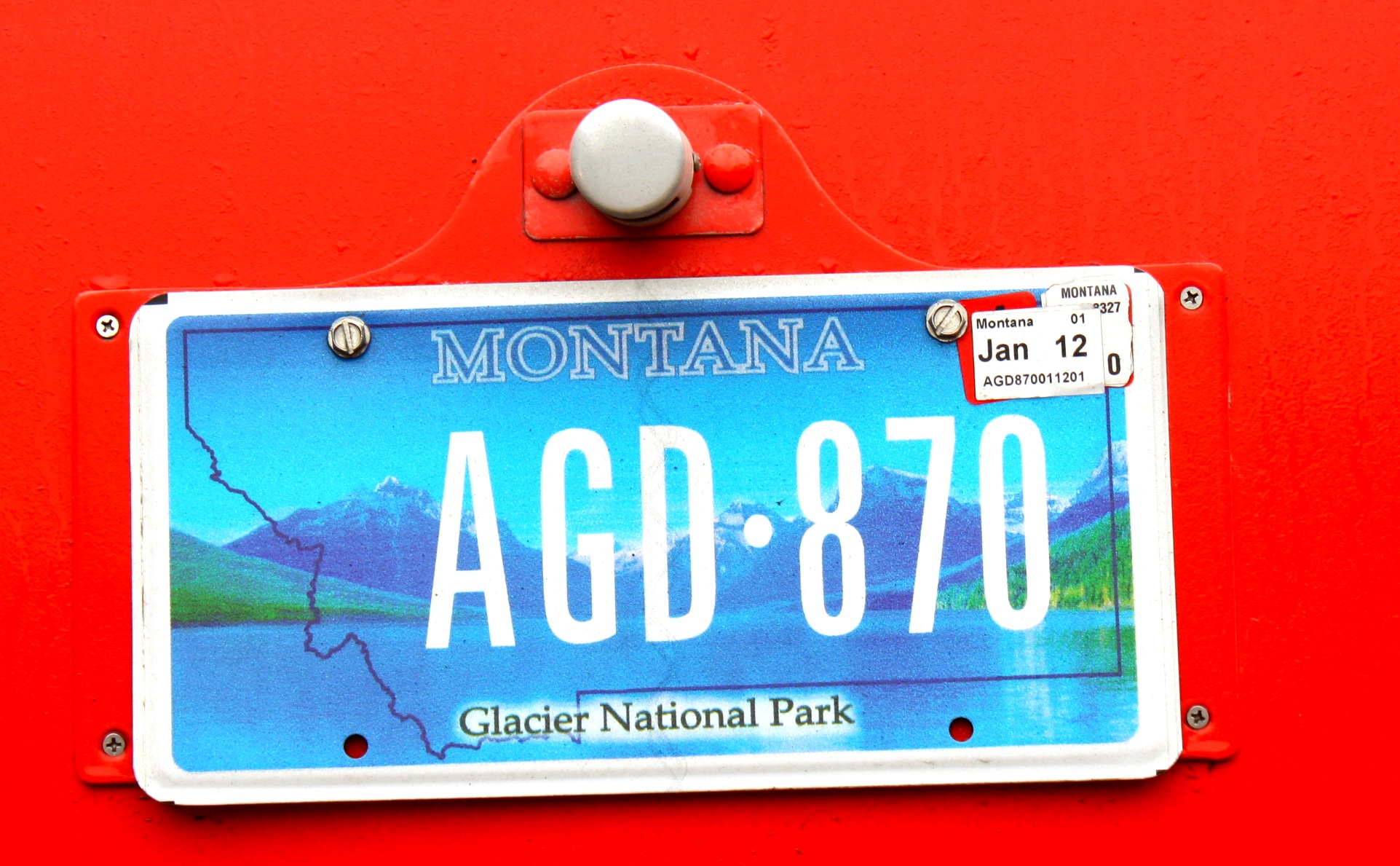 montana license plate on red vehicle