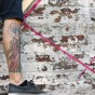 tattoo leg standing on ledge of wall during mural painting