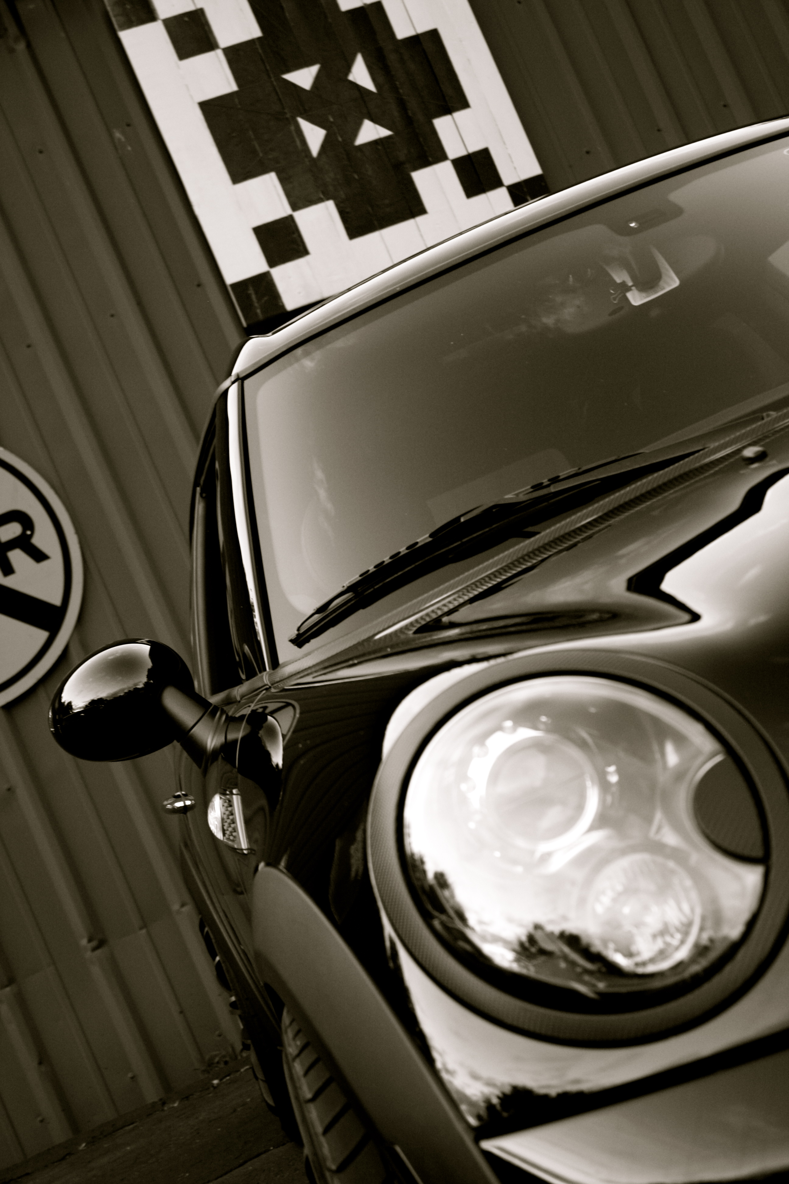 Mini Cooper black and white close up headlight