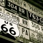 license plates and route 66 sign black and white